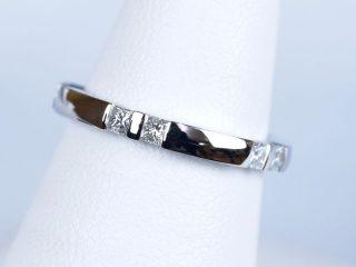 東京都のお客様 結婚記念日10周年を記念して、オーダーメイドの指輪を製作いたしました。10個のプリンセスカットを使っています。